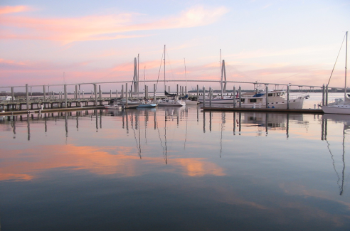 Charleston Harbor at sunrise. Photo via.